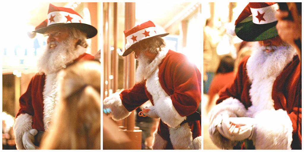 Old-timey Santa with a cowboy hat and ruddy cheeks.