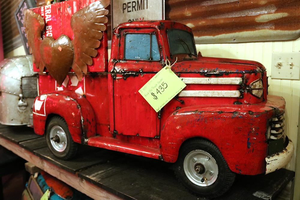 Antique metal truck for sale in Gruene Texas.