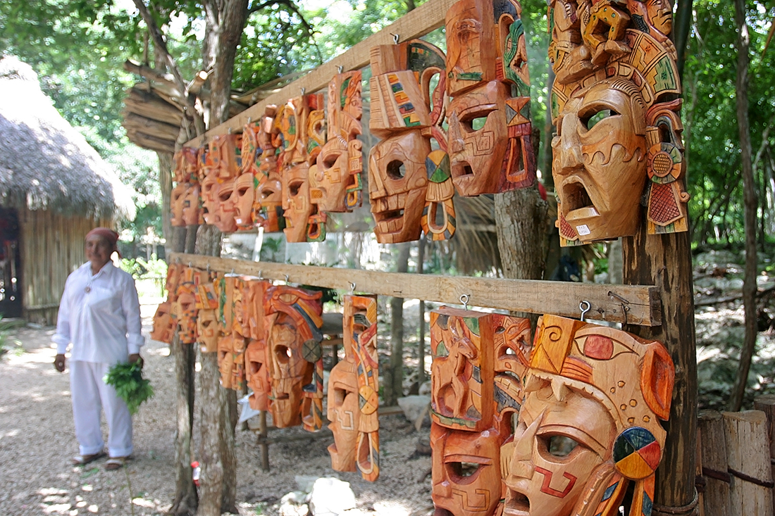 The masks seemed mass produced, but our guide claimed they were made in the village by Mayan descendants